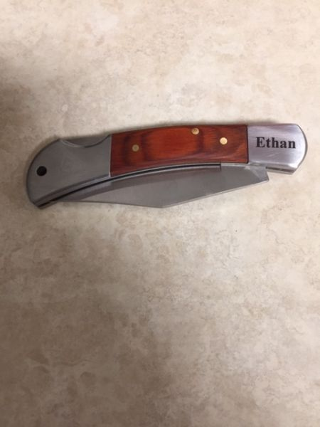 Metal knife engraving