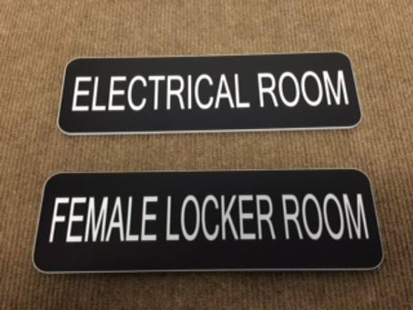 electrical room and female locker room signage